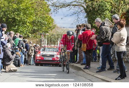Conflans-Sainte-Honorine,France-March 6 2016: The French cyclist Arnold Jeannesson of Cofidis Team riding during the prologue stage of Paris-Nice 2016.