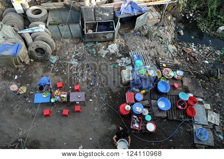 Outdoor restaurant near polluted river area with full of rubbish trash pollution environment unsafe food situation make poisoning for poor people at Ho Chi Minh city Viet Nam poster