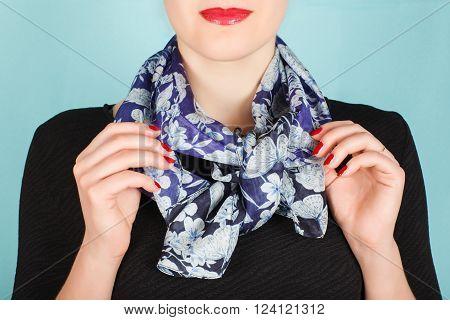 Silk Scarf. Blue Silk Scarf Around Her Neck Isolated On Blue Background.