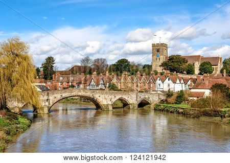 View of Aylesford village in Kent England with medieval bridge and church.