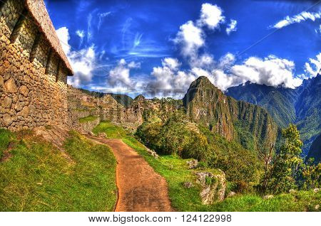 Colorful HDR image of a trail in Machu Picchu the lost Incan City of Machu Picchu near Cusco on a clear blue sky