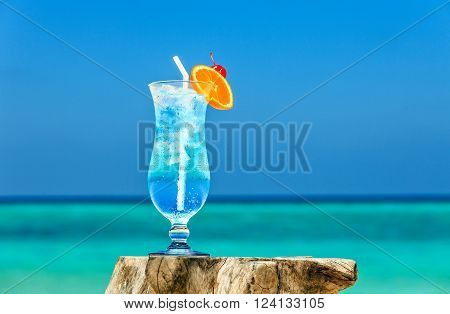 Bocal of cocktail is on sandy coral beach Maldives The Indian Ocean
