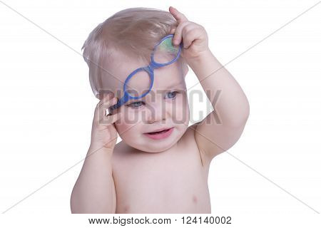 One year old boy with blue eyeglasses