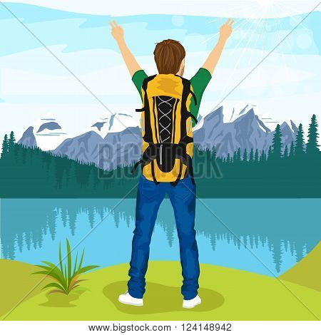 rear view of young male hiker with his hands up enjoying mountain lake