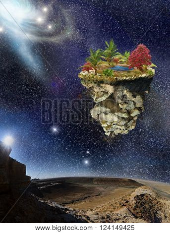 Island flying over the mountains landscape on the background stars sky