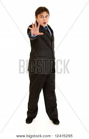 Full length portrait of scared young businessman isolated on white