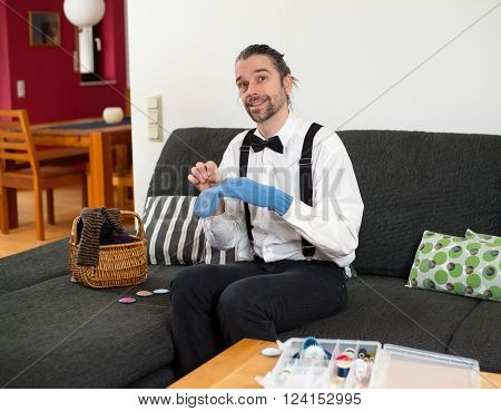 Man In White Shirt With Bow-tie Mending Sox