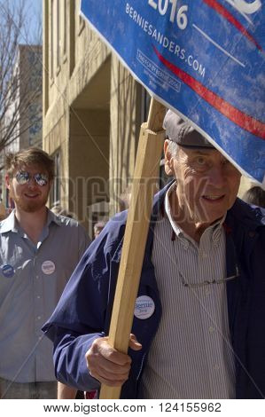 Asheville, Noth Carolina, USA - February 28, 2016: People of all ages carry Bernie Sanders support signs during a political rally in downtown Asheville NC