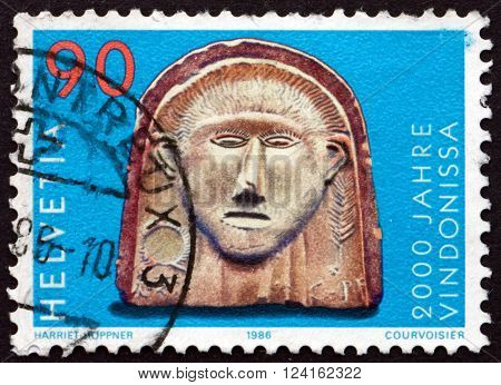 SWITZERLAND - CIRCA 1986: a stamp printed in the Switzerland shows Gallic Head Vindonissa Bimilennium circa 1986