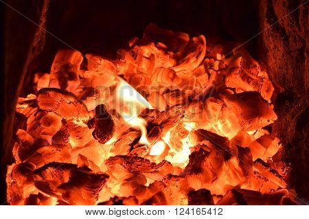 embers and flames in the small village kiln