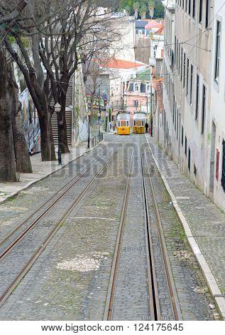 The steep slope of Elevador da Gloia vintage funicular railway Lisbon Portugal.