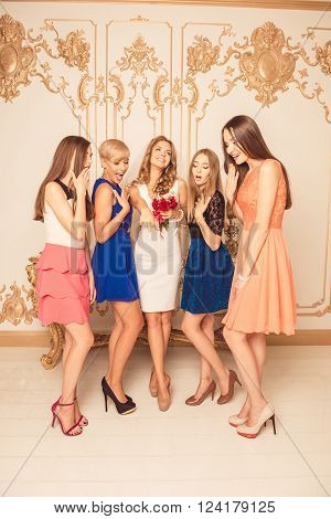 Cute girls looking suprised at wedding ring