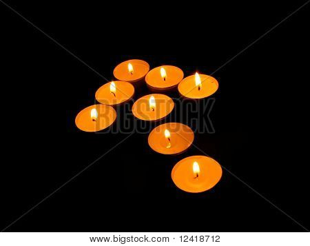 Burning candles in the form of arrows.