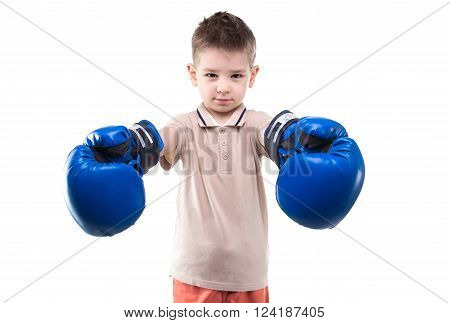 Smiling little boy with boxing gloves on white background