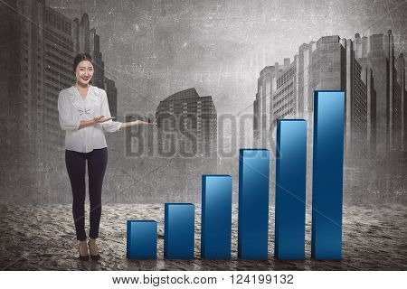 Pretty asian business woman show increase chart