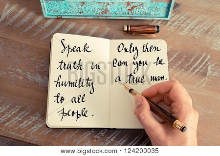 Retro effect and toned image of a woman hand writing on a notebook. Handwritten quote Speak truth in humility to all people. Only then can you be a true man as inspirational concept image