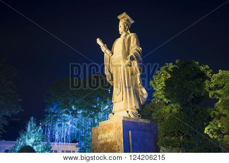 HANOI, VIETNAM - JANUARY 10, 2016: The monument of Emperor Ly Thai To in the night park. The landmark of Hanoi, Vietnam