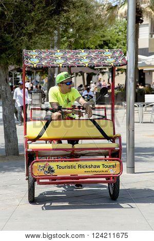 SPAIN, BARCELONA, JUNE, 27, 2015 - Bicycle rickshaw waiting for customers in Barcelonas street, Catalonia. Cycle rickshaw - very popular local transport.