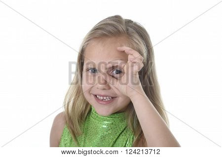 6 or 7 years old little girl with blond hair and blue eyes smiling happy posing isolated on white background circling eye in language lesson for child education and body parts school chart serie