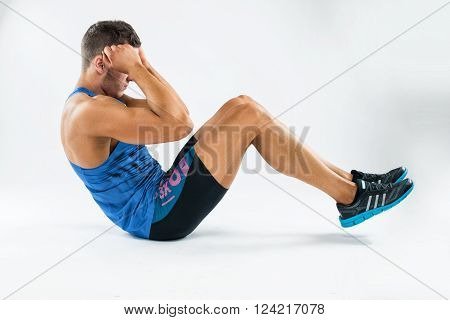 One Caucasian Man Exercising Crunches Fitness Weights Exercises In Studio