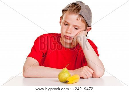 Morose Young Boy Staring At A Ripe Banana And Pear