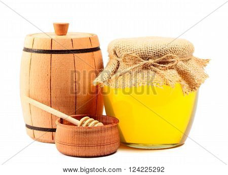 Wooden barrel and jar with honey isolated on white background
