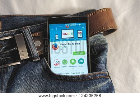 SARANSK, RUSSIA - April 3, 2016: Photo of Smartphone in a jeans pocket with Firefox application in a Google Play Store on the screen.