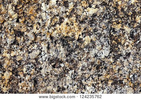 The textured surface of the granite stone. Close-up.
