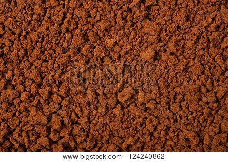Surface coated with the instant coffee grains as a background texture composition