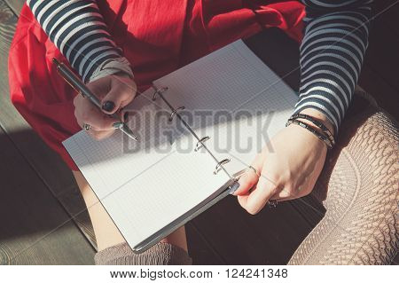 Cozy Photo Of Woman Writing In Notebook Sitting On The Floor