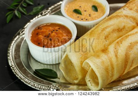 Dosa with chutney in steel plate south Indian breakfast