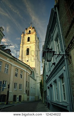 Photograph of St John's Church close to the university in Vilnius Lithuania during late afternoon/early evening in the summer. poster