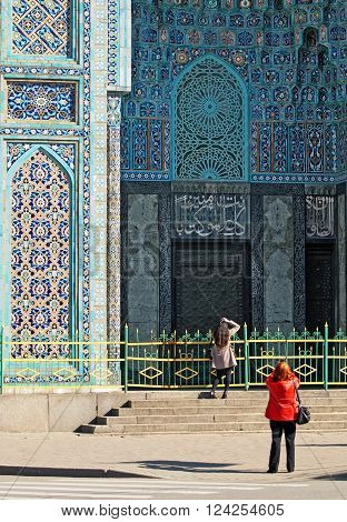 SAINT - PETERSBURG, RUSSIA - APRIL 3, 2016: People take pictures of the Saint-Petersburg Mosque. The Mosque was built in 1921