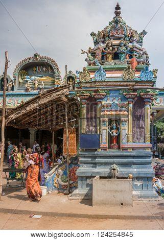 Trichy India - October 15 2013: Vishnu-Durga has her own shrine with small Vimanam full of statues at Amma Mandapam. Powerful image of Vaishnavism. Background is Ananta Shesha or Ranganatha Vishnu lying on the snake.