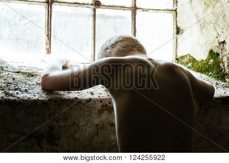 Depressed Shirtless Child Near Window