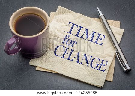 time for change - handwriting on a napkin with cup of coffee against gray slate stone background