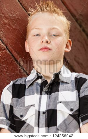 Handsome Little Boy Leaning Against Wall