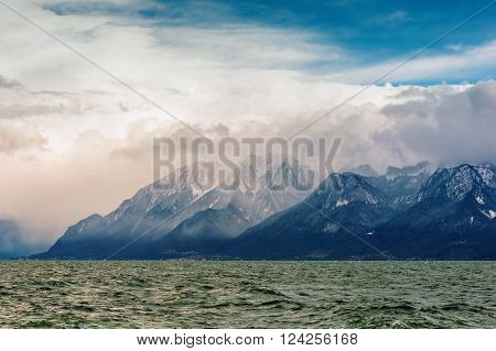 French Alps and lake Geneva or Leman on cloudy day