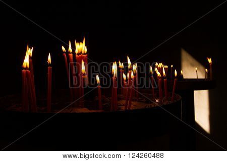 Red Votive Prayer Candles Burning in Christian Orthodox Church