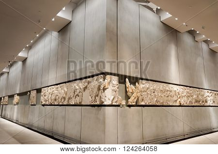 ATHENS, GREECE - JANUARY 28, 2011: Frieze on the 3rd level of the New Acropolis Museum, at night with no people