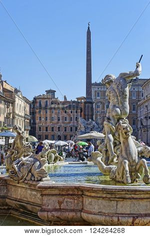 ROME ITALY - AUGUST 28 2012: Fountain of Neptune and Fountain of four Rivers with Egyptian obelisk in Piazza Navona in Rome in Italy. Piazza Navona is a famous piazza in Rome in Italy.