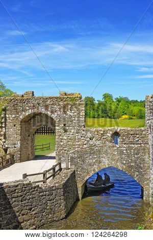 Gate of Leeds Castle which is in the island on the lake in Kent in England. The castle was built in the twelfth century as a king residence. Now it is open to the public.