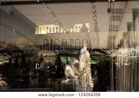 ATHENS GREECE - JANUARY 28 2011: Reflections of a pediment against the glass window on the 3rd level of the New Acropolis Museum at night