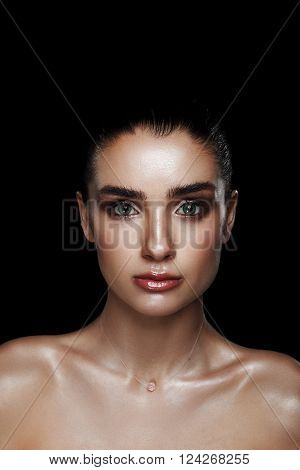 Beauty Portrait Of Pretty Woman With Strobing Makeup. Wet Body Effect. Strobing Or Highlighting Make