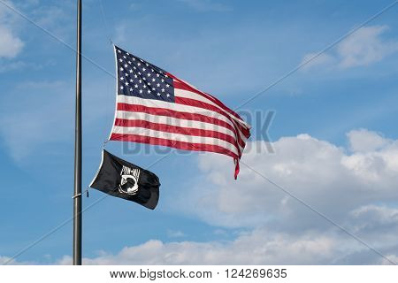 WASHINGTON, DC - MARCH 25, 2016: American and POW/MIA Flags flying over Washington DC