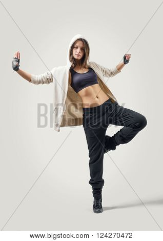 Young charming girl dancer leaping in Jazz Dance position