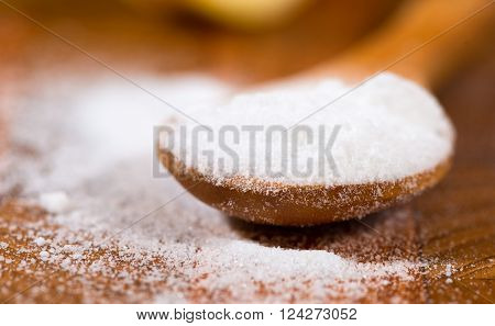 baking soda (Sodium bicarbonate) on a wooden spoon