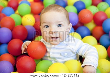 8 month baby boy playing in the playground balls pool ** Note: Visible grain at 100%, best at smaller sizes