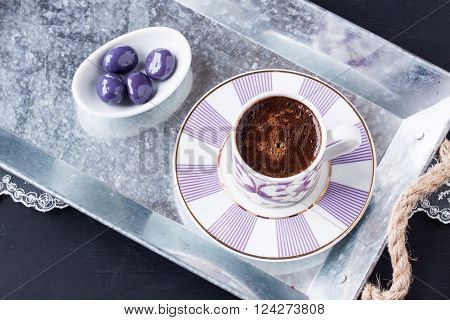 Turkish coffee and sugar coated chocolate on a tray