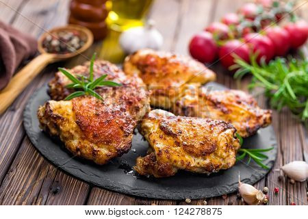 grilled chicken thighs with spices on a table